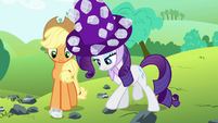 Rarity touching one of the rocks S4E18