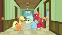 Granny Smith dressed in a hospital gown and mask S6E23