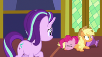 Pinkie Pie falls over on top of Applejack S7E14