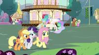 AJ, Rarity, and Fluttershy walk through Ponyville S7E1