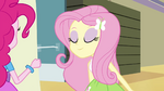 Fluttershy sniffing the poster EG2