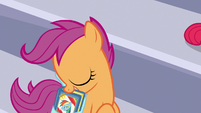 Scootaloo taking out her scrapbook S7E7