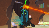 Queen Chrysalis eating a cupcake S9E8