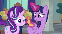 Twilight Sparkle looking at a pocketwatch S8E1