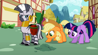 Applejack and Twilight look at the ground S2E06