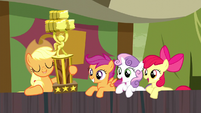 Applejack appears with hay stacking trophy S5E6