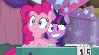 Twilight grinning wide behind Pinkie Pie S9E16