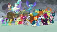 Ponies and creatures standing together S9E25