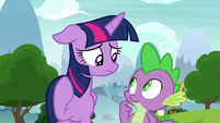 Twilight and Spike look at each other S8E24