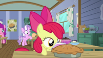 Apple Bloom carries the pie to the table S6E4
