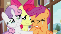 Scootaloo crying in her friends' hooves S9E12