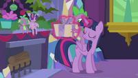 Twilight levitates present into Spike's hands S5E20