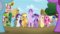 Starlight standing supported by Twilight and Applejack S5E26