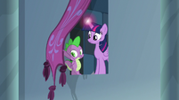 Twilight and Spike appear behind banner S9E4