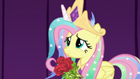 Fluttershy smiling with a hoofful of roses S8E7
