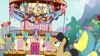 Ponies look at the smoldering banner S7E15