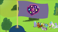 School of Friendship flag blowing in the wind S8E2