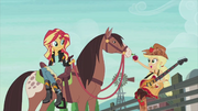 Applejack and Sunset with a horse EG2.png