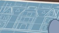 Hard Hat unfurling hospital blueprints S7E5
