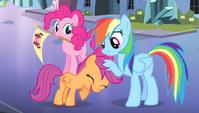 Rainbow Dash ruffling Scootaloo's mane S4E24