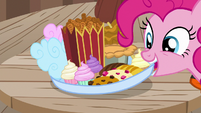 Pinkie Pie sets down a tray of treats S6E22