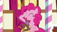 Pinkie with hoof on her right eye; Gummy pops out of the bowl S5E19