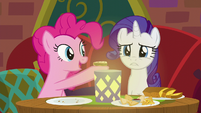 Pinkie Pie offering food to Rarity S6E12