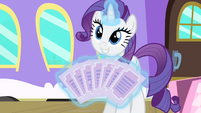 Rarity showing the tickets S4E08