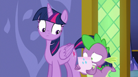 Spike reading Rarity's note S6E22