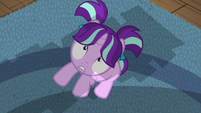 Filly Starlight looks up at toppling book tower S6E1