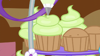 Icing being added on a cupcake S5E19