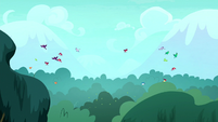 Birds flying away from the forest S8E18