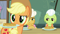 AJ looks behind while holding pancakes S9E10
