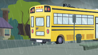School bus pulls away from the bus stop SS6