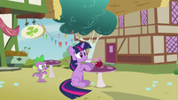 Twilight sat on the floor by the table S3E3