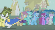 Rarity running away with Golden Harvest in background S1E6