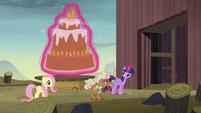 Twilight levitates cake through the McColts' gate S5E23