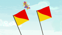 Rainbow's flags flapping in the wind S9E15