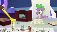 Discord sets his character stand on the table S6E17