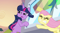 Twilight and Fluttershy holding the machine S2E22