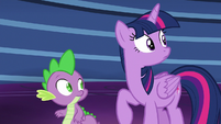 Twilight and Spike watch Starlight speed through the library S6E21