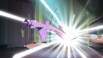 Twilight trying to pull Spike out of the comic book S4E06