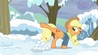 Applejack kicks a snowball at Pinkie Pie S5E5