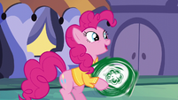 Pinkie happily spinning the arrow sign S6E12