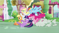 Pinkie racing her friends to the furniture store S5E19