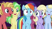 Rainbow Dash pushes through the crowd S8E5