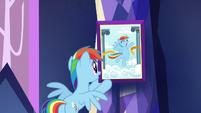 Rainbow hangs photo of herself S5E3