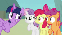 Twilight Sparkle whispering to the Crusaders S8E6