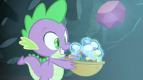 Gems being levitated into a basket held by Spike S6E5