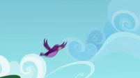 Purple bird flying through the sky CYOE4a